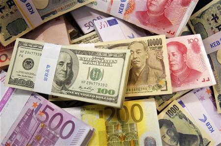 Banknotes from different countries at the main office of the Korea Exchange Bank are seen in this picture illustration taken in Seoul October 22, 2010. REUTERS/Truth Leem/Files