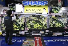 Sharp Corp's Aquos TVs are displayed at an electronics store in Tokyo October 28, 2012. REUTERS/Yuriko Nakao