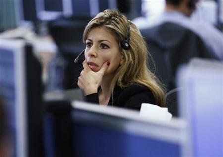 File photo of a female employee on IG Index's trading floor in London September 22, 2011. REUTERS/Andrew Winning/Files.