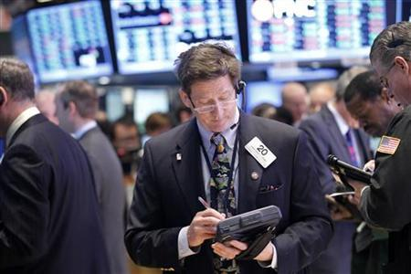 Traders work on the floor of the New York Stock Exchange, January 17, 2013. REUTERS/Brendan McDermid