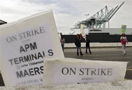 Analysis: U.S. ports' drive to control costs leads to labor strife