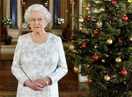 The Queen records her Christmas message in 3-D from the White Drawing Room of Buckingham Palace in central London December 7, 2012 in a photo released December 25, 2012. REUTERS/John Stillwell/Pool