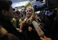 U.S. National Transportation Safety Board (NTSB) designated investigator Lorenda Ward (C) is surrounded by media upon her arrival at Takamatsu airport, where an All Nippon Airways (ANA) Boeing 787 Dreamliner plane made an emergency landing on Wednesday, in Takamatsu, western Japan January 18, 2013. REUTERS/Issei Kato
