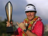 """Russell Henley of the U.S. celebrates with the trophy and gestures a """"Hawaiian Shaka"""" after winning final round of the Sony Open golf tournament shooting a 24 under par in Honolulu, Hawaii January 13, 2013. REUTERS/Hugh Gentry"""