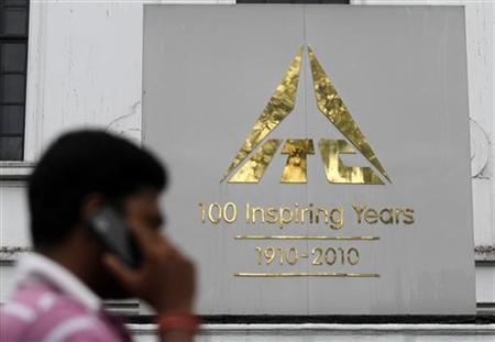 A man talks on his mobile phone as he walks past an ITC office building in Kolkata September 4, 2012. REUTERS/Rupak De Chowdhuri/Files