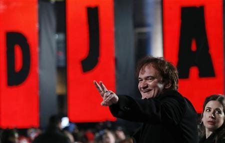 Director Quentin Tarantino gestures during the UK premiere of Django Unchained in central London January 10, 2013. REUTERS/Olivia Harris