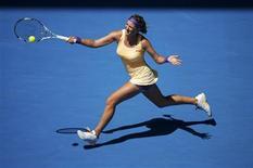 Victoria Azarenka of Belarus hits a return to Jamie Hampton of the U.S. during their women's singles match at the Australian Open tennis tournament in Melbourne, January 19, 2013. REUTERS/Daniel Munoz