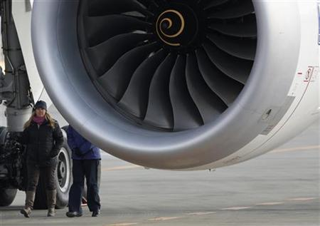U.S. National Transportation Safety Board (NTSB) inspection charge Lorenda Ward (L) inspects the All Nippon Airways' (ANA) Boeing Co's 787 Dreamliner plane which made an emergency landing on Wednesday, at Takamatsu airport in Takamatsu, western Japan January 18, 2013. REUTERS/Issei Kato