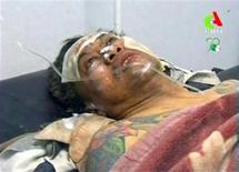 Fuerzas especiales de Argelia encontraron el sábado 15 cuerpos quemados en la planta de gas situada en el desierto que ha sido atacada por combatientes vinculados con Al Qaeda, dijo una fuente familiarizada con la crisis de los rehenes. En esta imagen congelada, un herido en una camana de un hospital tras ser liberado de la planta argelina, en Tigantourine el 18 de enero de 2013. REUTERS/Algerian TV via Reuters TV