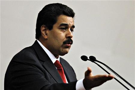 Venezuela's Vice President Nicolas Maduro delivers the state of nation address to national assembly in Caracas January 15, 2013. Maduro delivered the state of nation in absence of President Hugo Chavez who still recovering from a cancer surgery in Cuba. REUTERS/Carlos Garcia Rawlins