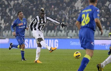 Juventus' Paul Pogba (C) shoots to score his second goal against Udinese during their Italian Serie A soccer match at the Juventus stadium in Turin January 19, 2013. REUTERS/Giorgio Perottino