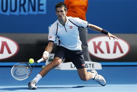 Novak Djokovic of Serbia hits a return to Radek Stepanek of Czech Republic during their men's singles match at the Australian Open tennis tournament in Melbourne, January 18, 2013. REUTERS/Tim Wimborne