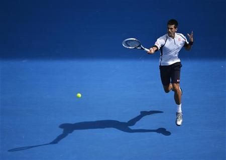 Novak Djokovic of Serbia hits a return to Radek Stepanek of Czech Republic during their men's singles match at the Australian Open tennis tournament in Melbourne, January 18, 2013. REUTERS/Toby Melville