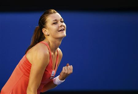 Radwanska storms past Ivanovic to extend streak