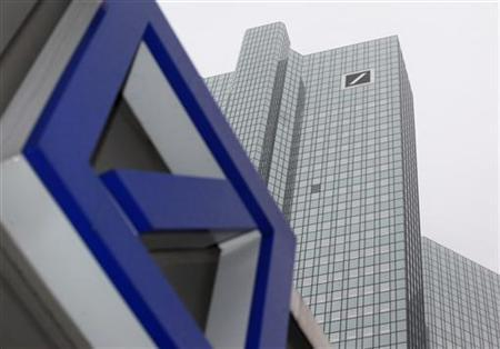 A Deutsche Bank logo is pictured in front of the Deutsche Bank headquarters in Frankfurt February 24, 2011. After a three-year renovation period the two Deutsche Bank towers are re-opened. REUTERS/Ralph Orlowski (GERMANY - Tags: BUSINESS)