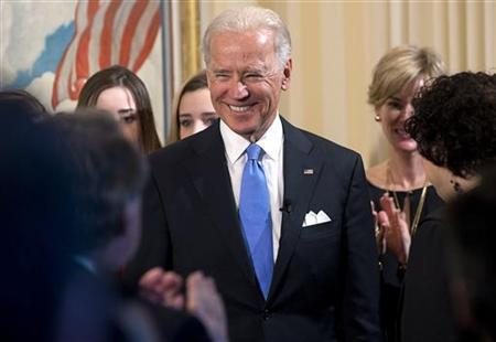 U.S. Vice President Joe Biden (C) is congratulated after being sworn in by Supreme Court Justice Sonia Sotomayor (R) at the U.S. Naval Observatory In Washington January 20, 2013. REUTERS/Saul Loeb/Pool