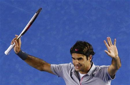 Roger Federer of Switzerland celebrates defeating Bernard Tomic of Australia in their men's singles match at the Australian Open tennis tournament in Melbourne January 19, 2013. REUTERS/David Gray