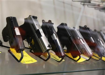 A display of 7-round handguns are seen at Coliseum Gun Traders Ltd. in Uniondale, New York January 16, 2013. REUTERS/Shannon Stapleton