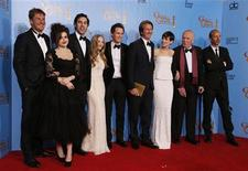 """The Cast of """"Les Miserables"""" (From L) producer Tim Bevan, Helena Bonham Carter, Sasha Baron Cohen, Amanda Seyfried, Eddie Redmayne, director Tom hooper, Anne Hathaway, unidentified and producer Eric Fellner, celebrate their win for Best Motion Picture, Comedy or Musical backstage at the 70th annual Golden Globe Awards in Beverly Hills, California, January 13, 2013. REUTERS/Lucy Nicholson"""