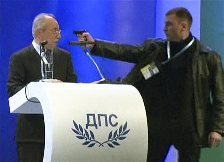 An unidentified man (R) attacks Ahmed Dogan, leader of Bulgaria's Movement for Rights and Freedom (MRF) party, as he delivers his speech during his party's annual conference at the National Palace of Culture in Sofia in this still image taken from video footage on January 19, 2013. REUTERS/BTV via Reuters TV