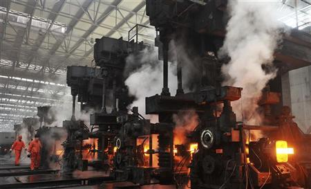 Employees work at a steel factory of Dongbei Special Steel Group in Dalian, Liaoning province January 18, 2013. China's economy regained speed in the final quarter of 2012, pulling out of a post-global financial crisis downturn that produced the slowest year of economic growth since 1999. REUTERS/China Daily