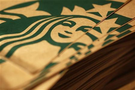 Branded packaging is seen in Starbucks' Vigo Street branch in Mayfair, central London January 11, 2013. REUTERS/Stefan Wermuth