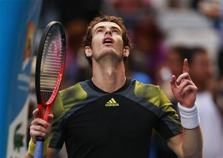 Andy Murray of Britain celebrates defeating Gilles Simon of France during their men's singles match at the Australian Open tennis tournament in Melbourne January 21, 2013. REUTERS/Tim Wimborne