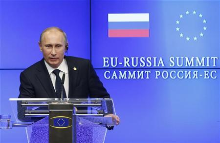 Russian President Vladimir Putin speaks during a joint news conference with European Council President Herman Van Rompuy and European Commission President Jose Manuel Barroso (unseen) following a European Union-Russia summit in Brussels December 21, 2012. REUTERS/Francois Lenoir