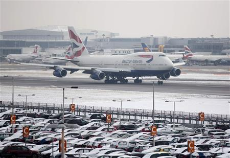 A British Airways aircraft takes off after snowfall at Heathrow airport in London January 21, 2013. REUTERS/Neil Hall