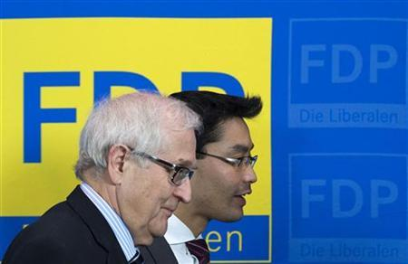 German Economy Minister and leader of the liberal Free Democratic Party (FDP) Philipp Roesler (R) and FDP parliamentary faction leader Rainer Bruederle leave a news conference at the FDP headquarters in Berlin, January 21, 2013, after proposing Bruederle as the party's top candidate in the general election later this year. REUTERS/Thomas Peter (GERMANY - Tags: POLITICS ELECTIONS)