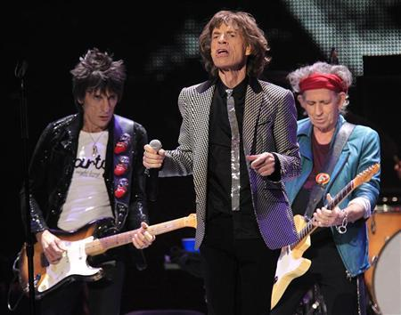 Ronnie Wood (L) Mick Jagger and Keith Richards perform onstage during the Rolling Stones final concert of their ''50 and Counting Tour'' in Newark, New Jersey, December 15, 2012. REUTERS/Carlo Allegri