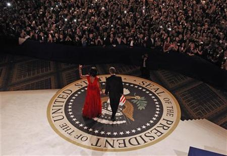 U.S. first lady Michelle Obama, wearing a Jason Wu dress, arrives with U.S. President Barack Obama for their dance at the Commander in Chief's ball in Washington, January 21, 2013. REUTERS/Pablo Martinez Monsivais/POOL (UNITED STATES - Tags: POLITICS ENTERTAINMENT)