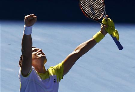 David Ferrer of Spain celebrates defeating compatriot Nicolas Almagro during their men's singles quarter-final match at the Australian Open tennis tournament in Melbourne January 22, 2013. REUTERS/Navesh Chitrakar