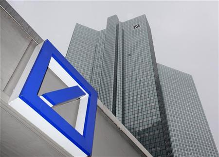 A Deutsche Bank logo is pictured in front of the Deutsche Bank headquarters in Frankfurt February 24, 2011. After a three-year renovation period the two Deutsche Bank towers are re-opened. REUTERS/Ralph Orlowski