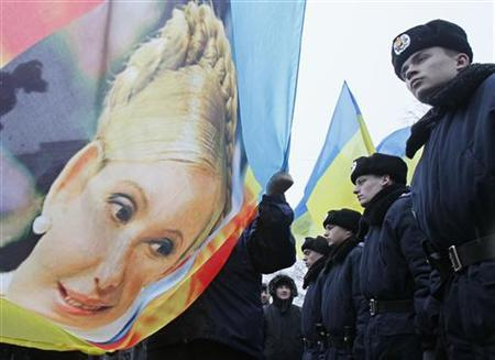Ukrainian opposition supporters hold a banner of former Prime Minister Yulia Tymoshenko during a rally in support of Tymoshenko near the presidential administration building in Kiev, January 21, 2013. REUTERS/Gleb Garanich