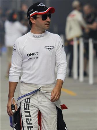 Marussia Formula One driver Timo Glock of Germany walks in the pit lane before the first practice session of the Indian F1 Grand Prix at the Buddh International Circuit in Greater Noida, on the outskirts of New Delhi, October 26, 2012. REUTERS/Vivek Prakash