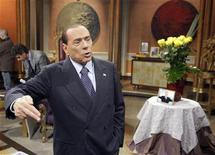 """Former Italian Prime Minister Silvio Berlusconi gestures before the taping of the talk show """"Telecamere"""" at Rai television in Rome January 11, 2013. REUTERS/Remo Casilli"""
