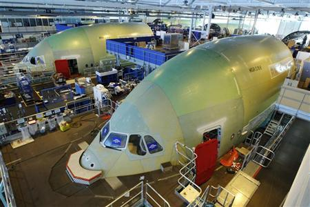 Airbus employees work in the fuselage section of an A380 Airbus airplane at the Airbus facility in Montoir-de-Bretagne near Saint-Nazaire January 20, 2011. REUTERS/Stephane Mahe