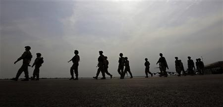 Nigerian soldiers walk on the tarmac of Bamako airport January 22, 2013. The first West African regional forces arrived in Mali to reinforce French and Malian troops battling to push back al Qaeda-linked rebels REUTERS/Eric Gaillard (MALI - Tags: CIVIL UNREST CONFLICT MILITARY)