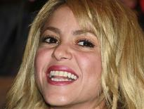Colombian singer Shakira smiles before being awarded Knight of Arts and Letter by French Culture Minister Frederic Mitterrand (not pictured) during the MIDEM (International Record Music Publishing and Video Music Market) in Cannes January 28, 2012. REUTERS/Eric Gaillard