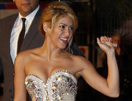 Colombian singer Shakira waves as she arrives at the Cannes festival palace to attend the NRJ Music Awards in Cannes January 28,2012. REUTERS/Eric Gaillard