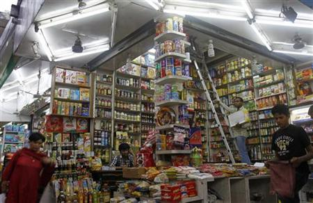 Customers shop in a family-owned store at a market in New Delhi September 18, 2012. REUTERS/Mansi Thapliyal/Files