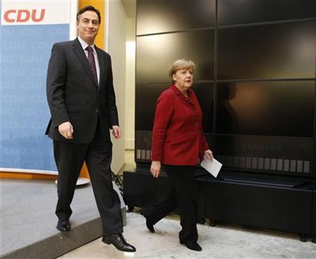 German Chancellor Angela Merkel (R), leader of the Christian Democratic Union party CDU and Lower Saxony federal state premier David McAllister leave a news conference in Berlin January 21, 2013. REUTERS/Fabrizio Bensch