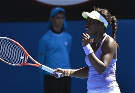Sloane Stephens of the U.S. celebrates defeating compatriot Serena Williams during their women's singles quarter-final match at the Australian Open tennis tournament in Melbourne January 23, 2013. REUTERS/Toby Melville
