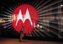 A man walks by a video display at the Motorola booth on the second day of the Consumer Electronics Show (CES) in Las Vegas January 7, 2011. REUTERS/Rick Wilking