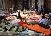 Refugees sit in a mattress camp in Votivkirche church in Vienna January 23, 2013. REUTERS/Heinz-Peter Bader