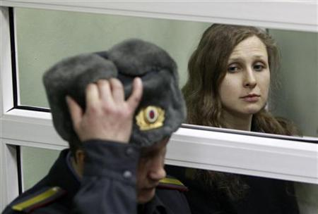 A member of the female punk band ''Pussy Riot'' Maria Alyokhina listens to the verdict inside a defendants' box during a court hearing in Berezniki in Perm region, near the Ural mountains, January 16, 2013. REUTERS/Sergei Karpukhin