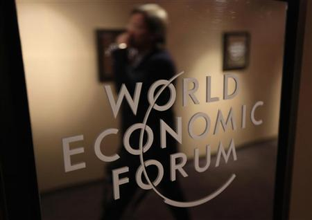 A participant is reflected in a mirror during the annual meeting of the World Economic Forum (WEF) in Davos, January 23, 2013. REUTERS/Denis Balibouse