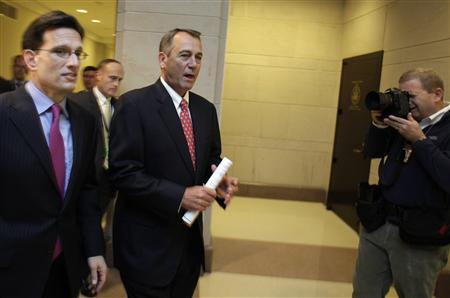 U.S. House Speaker John Boehner (R-OH) (C) and House Majority Leader Eric Cantor (R-VA) (L) arrive at a news conference on the ''fiscal cliff'' on Capitol Hill in Washington, December 21, 2012. REUTERS/Yuri Gripas