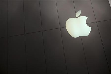 The Apple logo is shown on the front of the company's flagship retail store in San Francisco, California January 23, 2013. REUTERS/Robert Galbraith